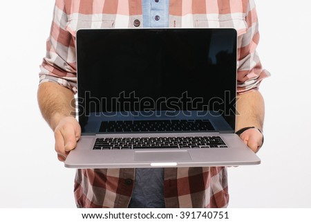 Close up of demonstrating of laptop in hands against white background