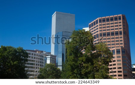 Close-Up of Denver Skyscrapers With Blue Sky - stock photo