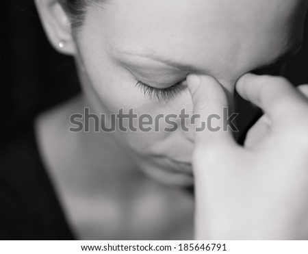 Close up of depressed woman. - stock photo