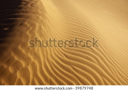 close-up of desert sand pattern in the Sahara - stock photo
