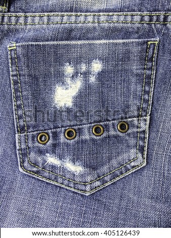 Close up of destroyed torn denim  jeans patch - stock photo