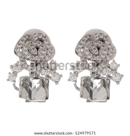 Close up of diamond earrings isolated on white background.