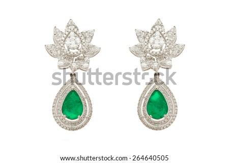 Close up of diamond earrings with diamonds isolated over white background - stock photo
