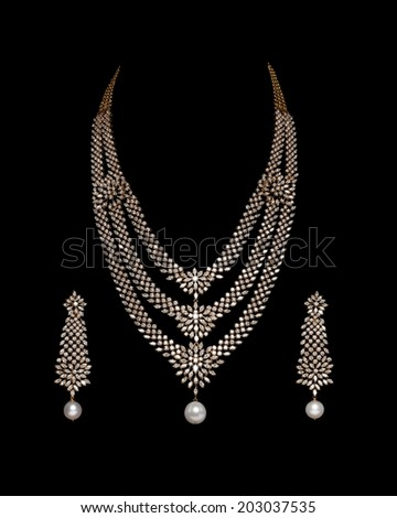Close up of diamond necklace on black background with diamond earring - stock photo