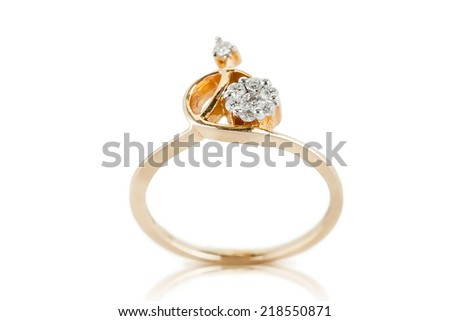 Close -up of diamond ring having many diamonds gem over white background