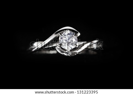 close up of diamond ring with black background - stock photo