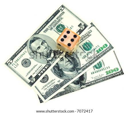 Close up of dice on dollars - stock photo