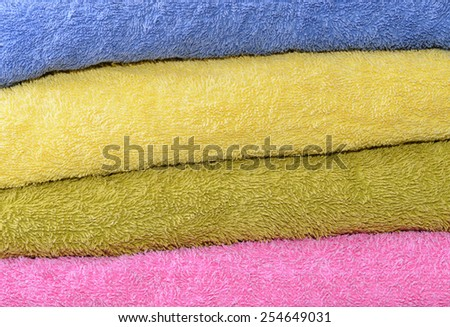 Close up of different color bath towels - stock photo
