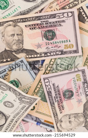 Close up of different dollar bills. Isolated as a background. - stock photo