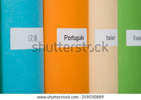 Close-up Of Different Languages Label On Colorful Book - stock photo