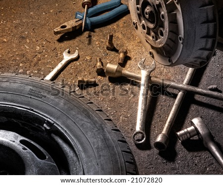 Close up of different tools for wheel change - stock photo