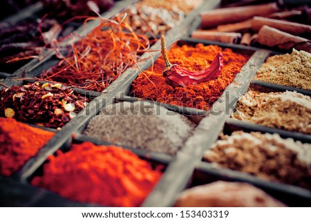 Close-up of different types of Assorted Spices in a wooden box. - stock photo