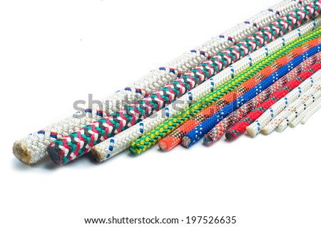 Close up of different types of ropes and cords, isolated on white background