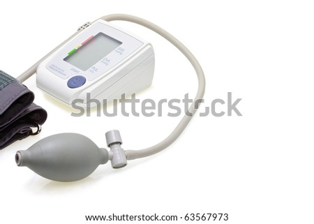 Close up of digital blood pressure meter isolated on white background