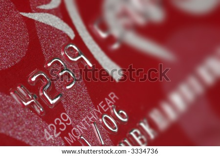 Close-up of digits on a credit card. Visible texture of the card. - stock photo