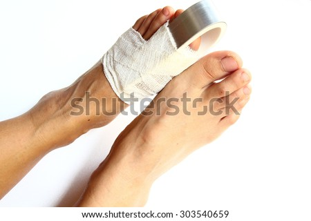 Close-up of disabled Patient's in aluminium foot splint on white background.  broken thumb pedicures. broken foot. wound healing.