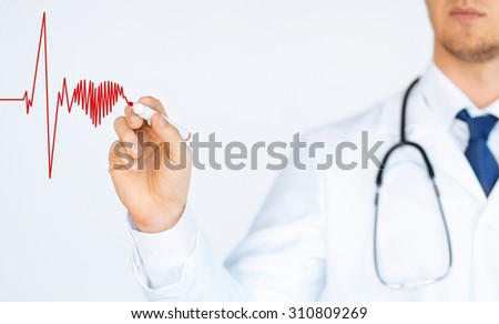 close up of doctor drawing electrocardiogram on virtual screen - stock photo