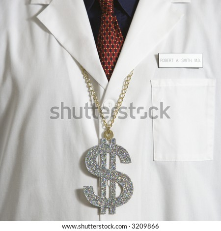 Close up of doctor wearing necklace with over-sized dollar sign. - stock photo