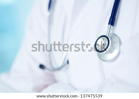 Close-up of doctor with stethoscope - stock photo