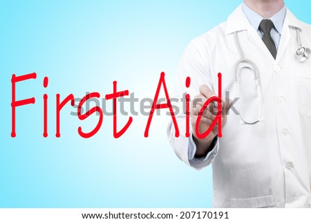 close up of doctor writing word first aid on screen glass with marker pen - stock photo