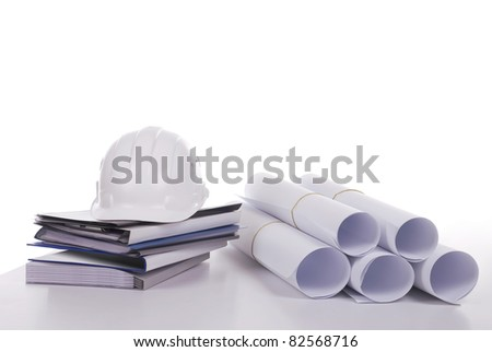 Close-up of documents, drawings and helmet - stock photo