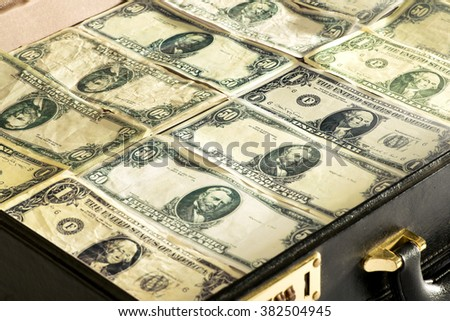 Close up of dollar banknotes or greenbacks closely packed into a briefcase or bag conceptual of wealth, success, investment, payment, finances, bribe or money laundering