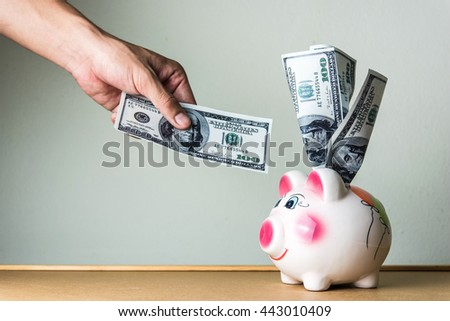 Close up of dollar cash money and piggy bank on table. business, finance, investment, saving and corruption concept.  - stock photo