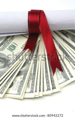 Close-up of dollars and a diploma with red ribbon - stock photo
