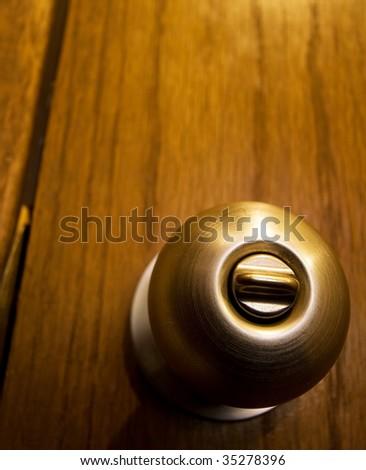 Close up of door knob on cheap wooden door. - stock photo
