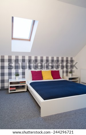 Close-up of double bed in cozy bathroom interior - stock photo