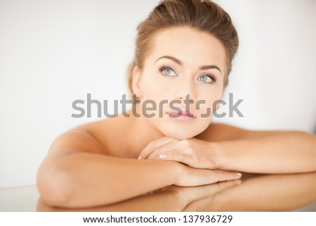 close up of dreaming woman lying on the mirror - stock photo