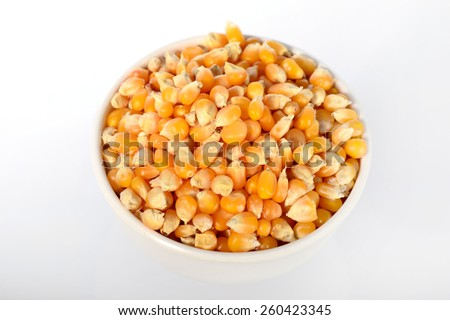 Close up of Dried corn in bowl used for making popcorn  - stock photo