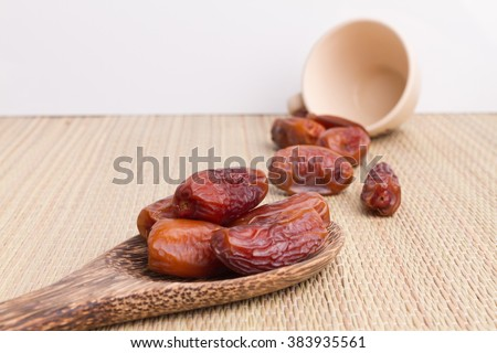 Close up of Dried dates fruit on matt - stock photo