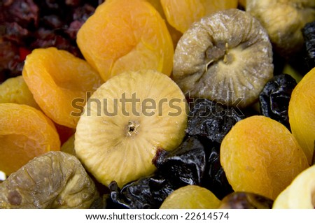 Close-up of dried fruits arranged in a basket - stock photo