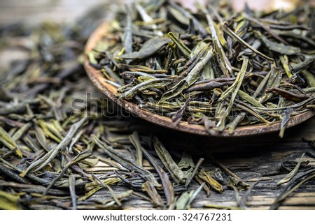 Close up of dried green tea leaves - stock photo