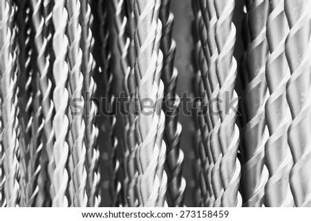 Close up of drill bits as a background image in black and white - stock photo