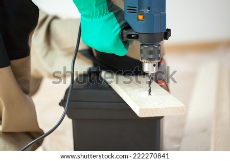 Close-up of drilling in wooden plank, horizontal - stock photo