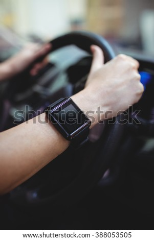 Close up of driver with smart watch in van