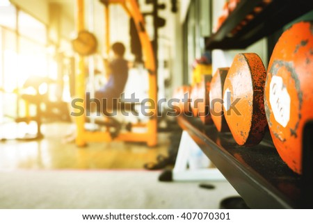 Close up of dumbbell exercise weights at fitness gym vintage tone. - stock photo