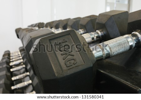 Close up of dumbbell rack - stock photo