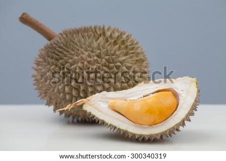 Close up of durian with orange yellowish flesh. - stock photo