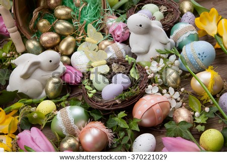 Close up of Easter assortiment of Easter eggs, spring flowers, and toys. - stock photo