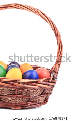 close up of Easter eggs and basket. isolated on a white background - stock photo