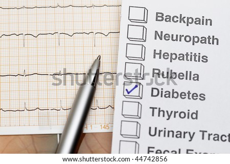 close up of ecg graph medical background and diabetes result - stock photo