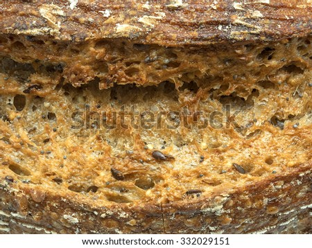 Close up of ecological wheat and rye bread with sesame seeds, flax and sunflower seeds - stock photo