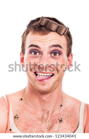Close up of ecstatic transvestite man making funny faces, isolated on white background.