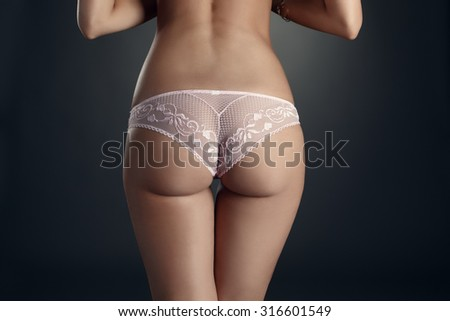 Close-up of elastic woman's ass in lace panties - stock photo