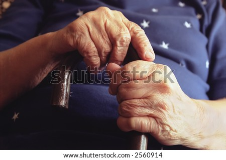 Close-Up of Elderly Woman Holding Cane - stock photo