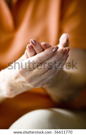 Close-up of elderly woman's hands - stock photo