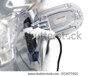 Close up of electric car charging nozzle on white background - stock photo
